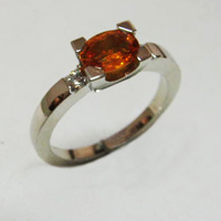 bague saphir mandarine 0ct94 diamants 0ct12 or 5grs